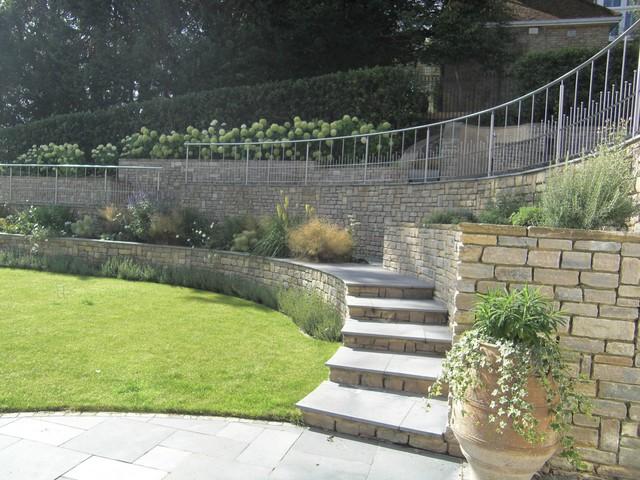Steeply sloping large garden in surrey uk modern for Garden design solutions