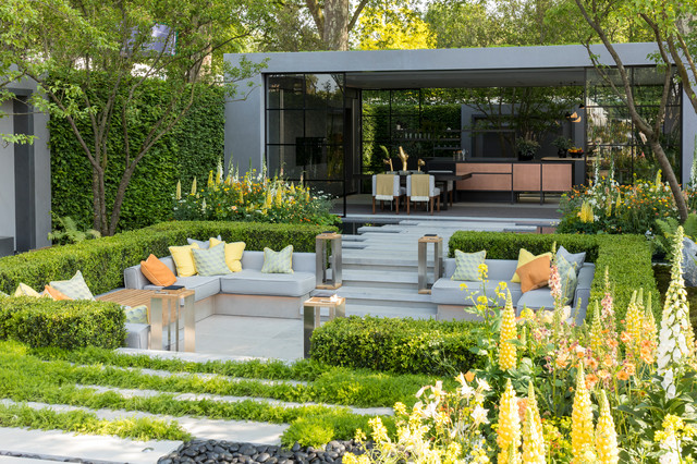 Design ideas for a large contemporary stone formal garden in London.