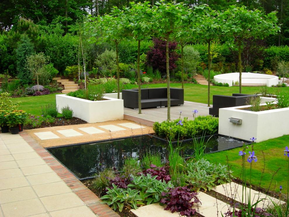 Design ideas for a large contemporary full sun backyard concrete paver formal garden in Surrey.