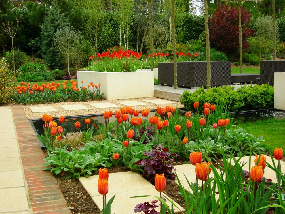Inspiration for a large contemporary full sun backyard concrete paver formal garden in Surrey.