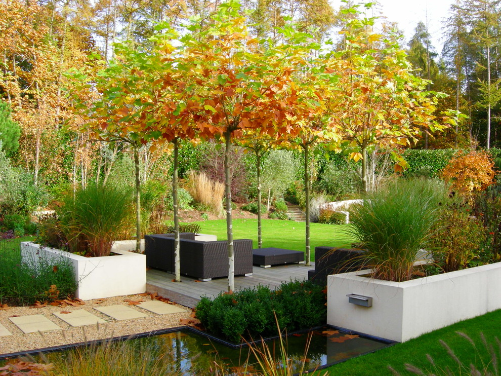 Design ideas for a large contemporary full sun backyard concrete paver formal garden in Surrey.