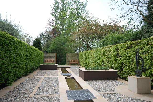 Inspiration For A Contemporary Full Sun Gravel Formal Garden In Other.