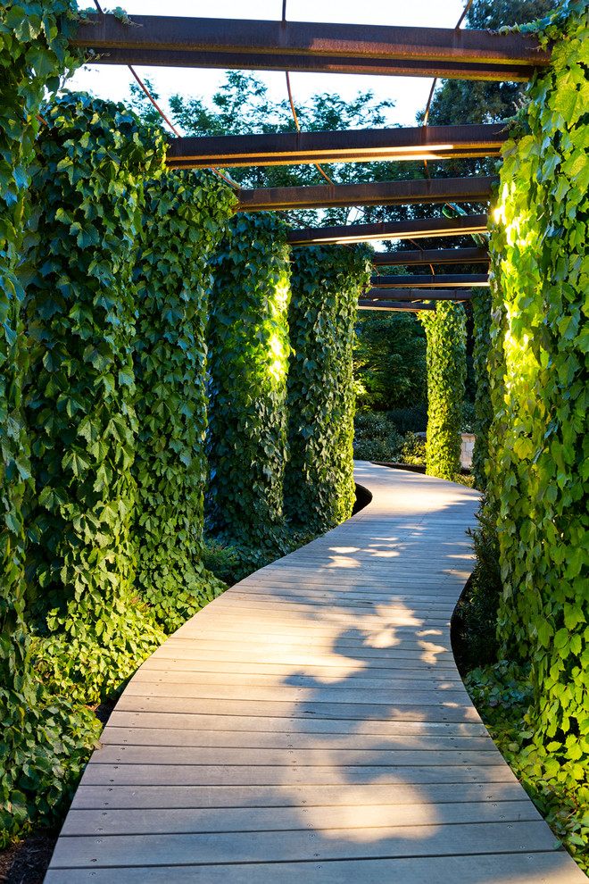 Inspiration for a contemporary partial sun garden path in Melbourne with decking.