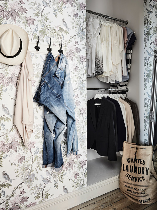 floral wall with hanging clothes