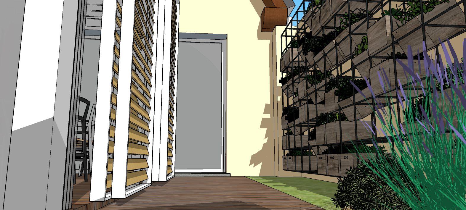 Dettaglio del vialetto d'ingresso e della zona per la coltivazione di erbe aroma