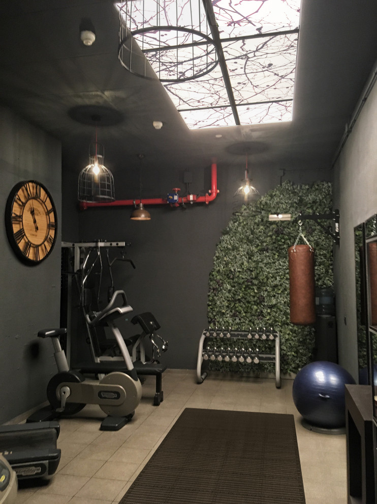 Multiuse home gym - small industrial ceramic tile and gray floor multiuse home gym idea in Barcelona with black walls