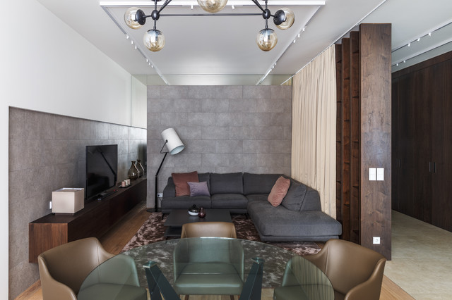 Living room - contemporary formal and open concept living room idea in Moscow with gray walls and a tv stand