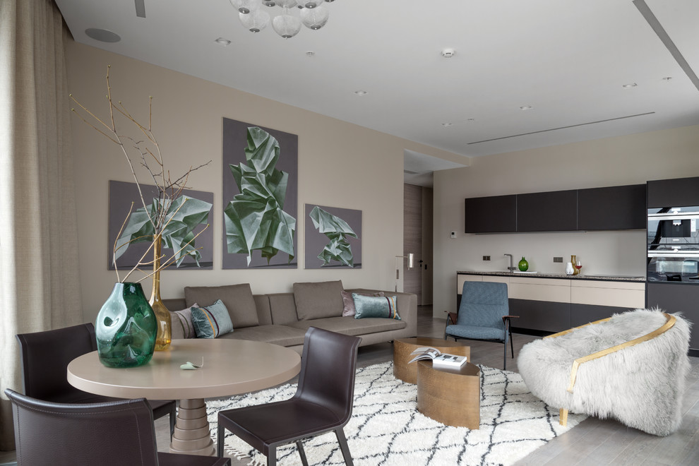 Mid-sized trendy formal and open concept light wood floor and gray floor living room photo in Moscow with beige walls