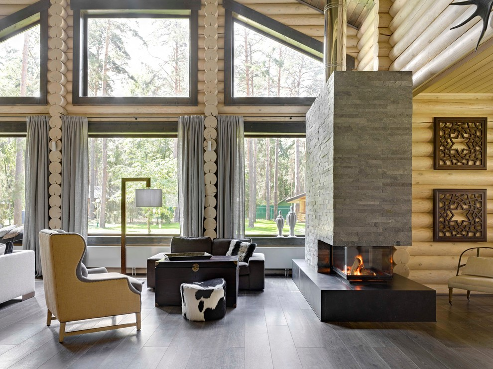 Large mountain style open concept dark wood floor living room photo in Moscow with a two-sided fireplace, a stone fireplace and beige walls
