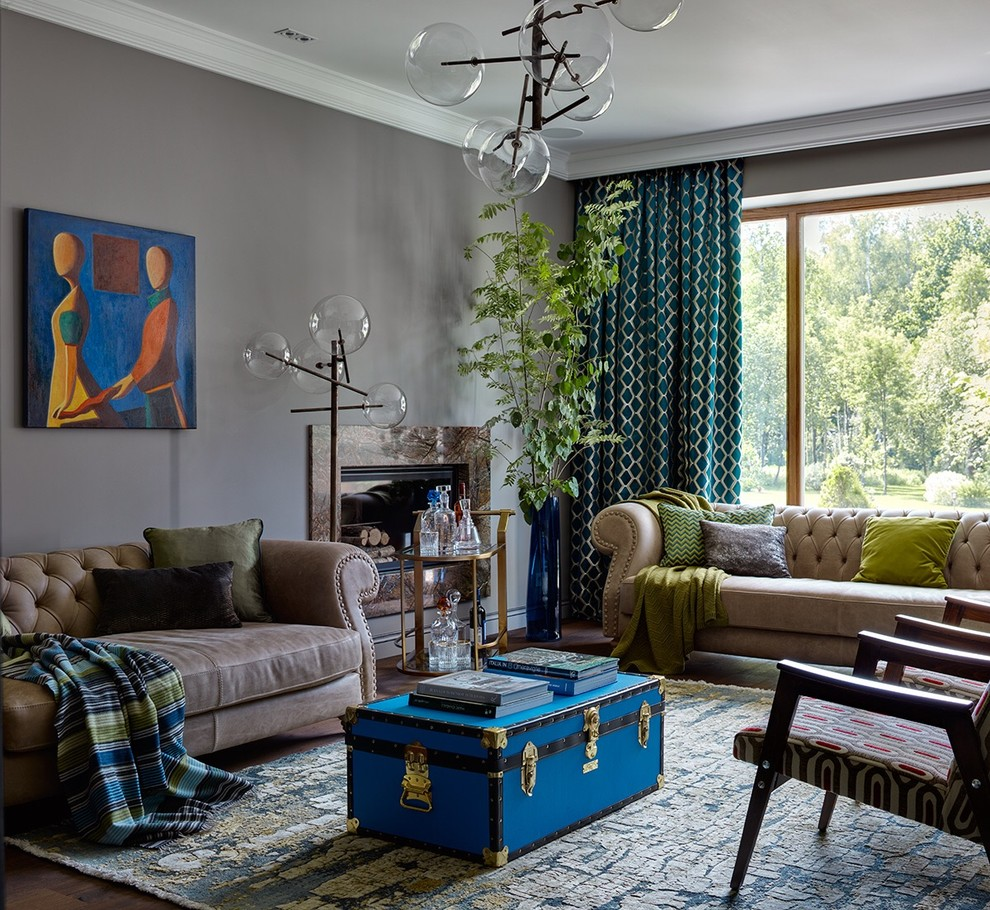 Inspiration for an eclectic open concept living room remodel in Moscow with a bar, gray walls, a standard fireplace, a metal fireplace and no tv