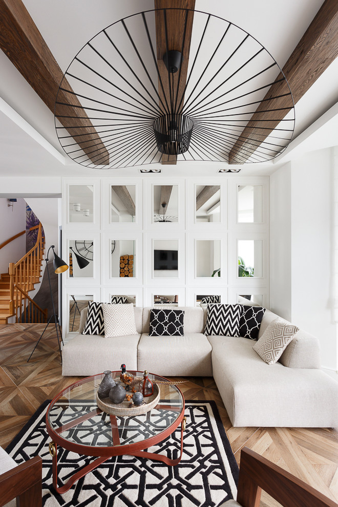 Example of a trendy open concept medium tone wood floor and brown floor living room design in Other with white walls