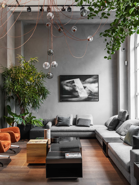 Living room - contemporary medium tone wood floor living room idea in Moscow with gray walls and no tv