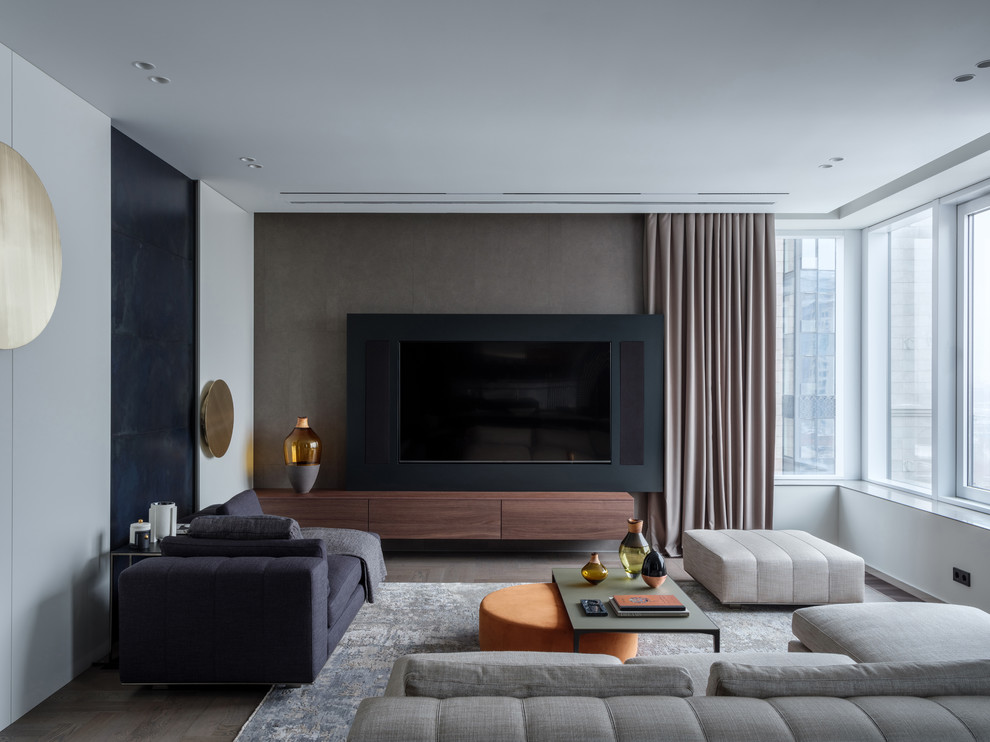 Trendy brown floor and medium tone wood floor living room photo in Moscow with beige walls and a media wall