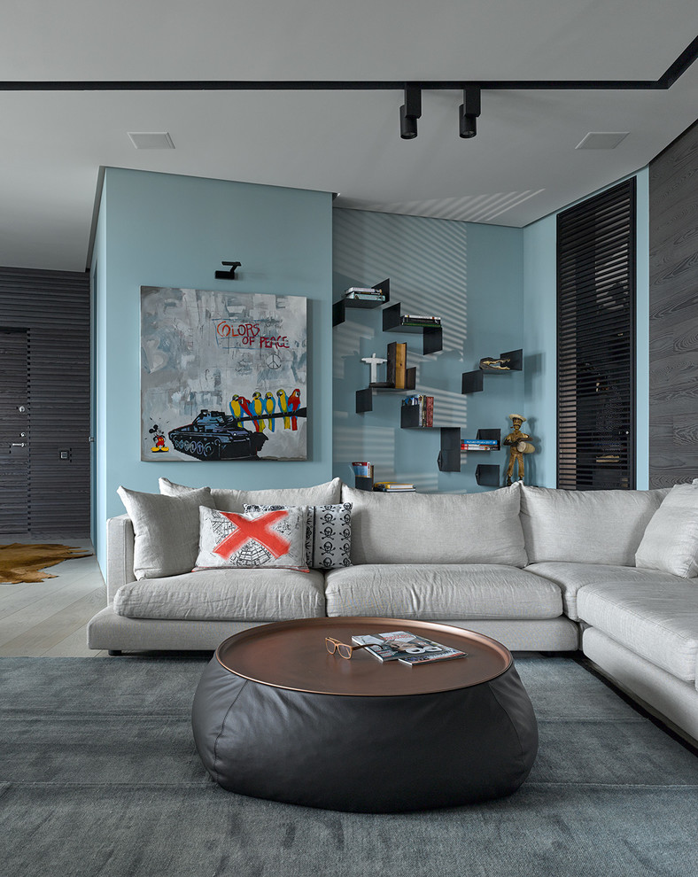 Inspiration for a contemporary open concept and formal light wood floor living room remodel in Other with blue walls, no fireplace and no tv