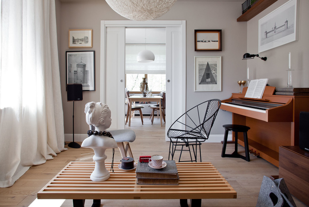 Inspiration for a scandinavian enclosed light wood floor living room remodel in Moscow with a music area and gray walls