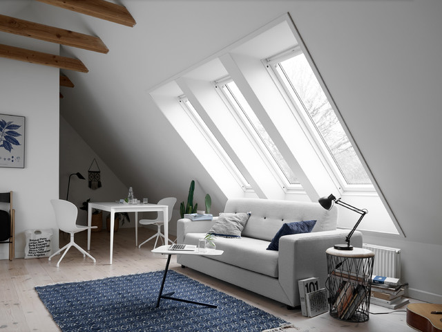 Example of a danish formal light wood floor living room design in Moscow with white walls