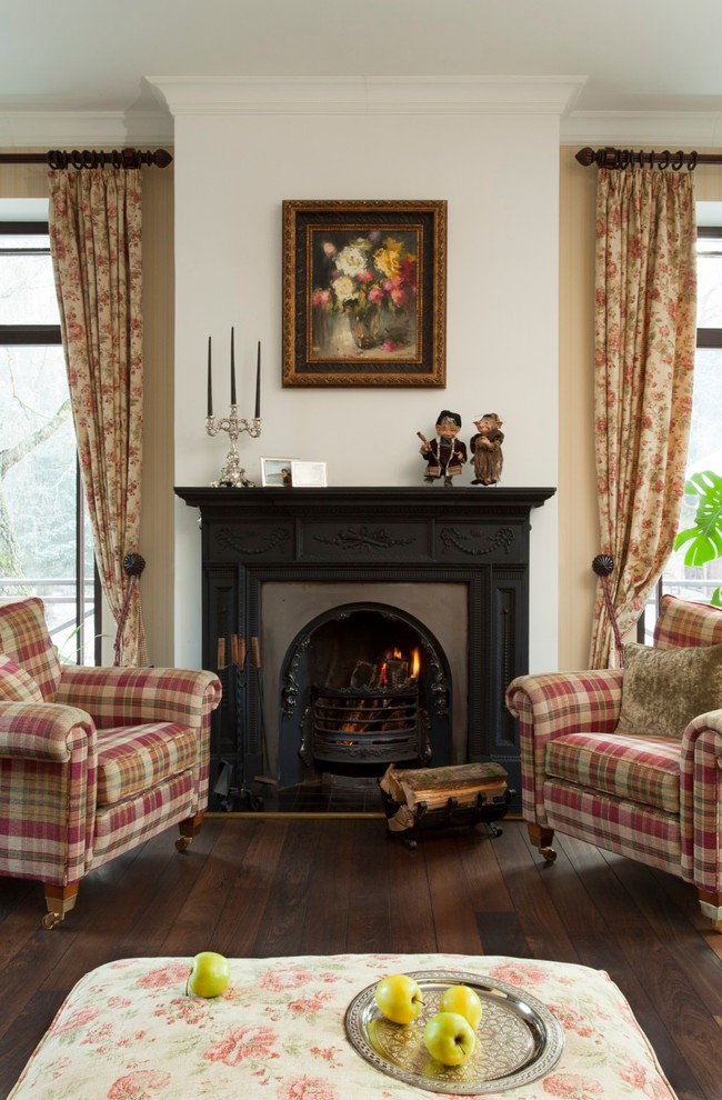 Inspiration for a timeless dark wood floor living room remodel in Moscow with beige walls and a standard fireplace