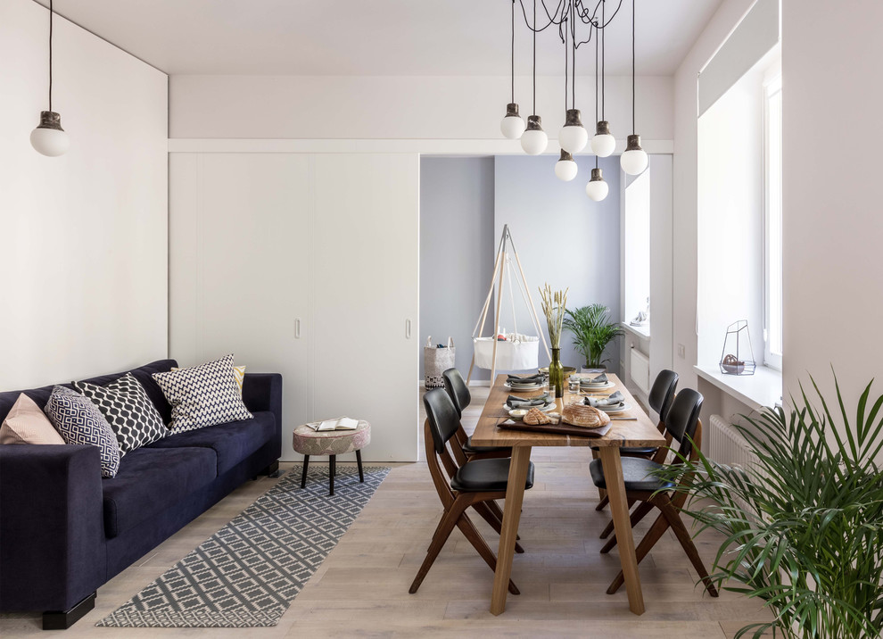 Small danish open concept light wood floor and beige floor living room photo in Moscow with white walls, no fireplace and no tv