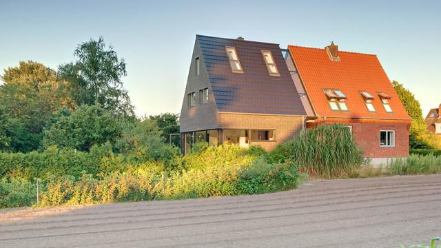 Anbau an ein siedlungshaus modern haus fassade for Anbau haus modern