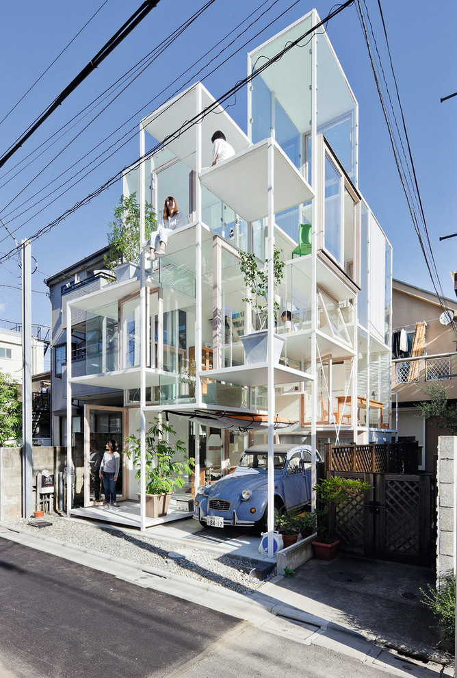 Inspiration for a small contemporary white three-story mixed siding exterior home remodel in Berlin