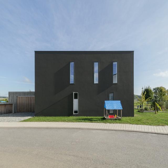 Gesamtwerk Architektur architektur ein grauer kubus lässt die landschaft leuchten