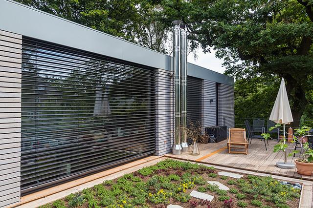 Holzrahmenbau details flachdach  Einfamilienhaus Holzrahmenbau mit Flachdächern - Modern - Häuser ...