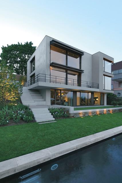 Fassade mit Garten minimalistisch-haeuser