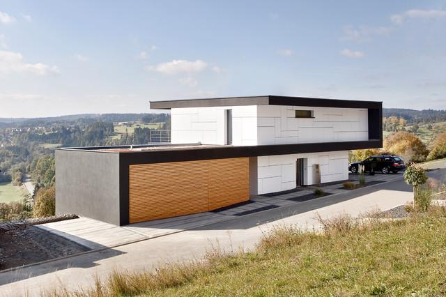 Haus m modern h user stuttgart von m3 architekten for How to build a house on a steep slope