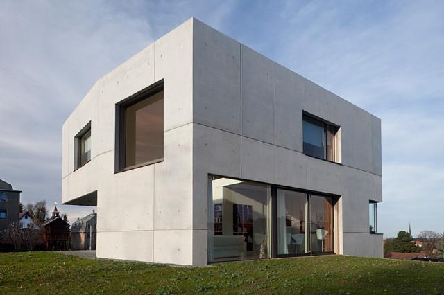 Maison du b ton contemporain fa ade leipzig par for Architecture hexagonale