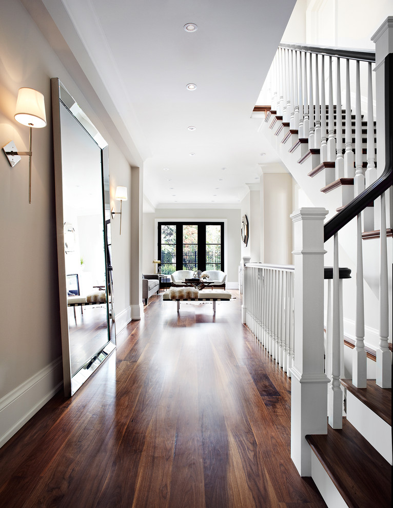 Inspiration for a transitional dark wood floor and brown floor hallway remodel in Dallas with beige walls