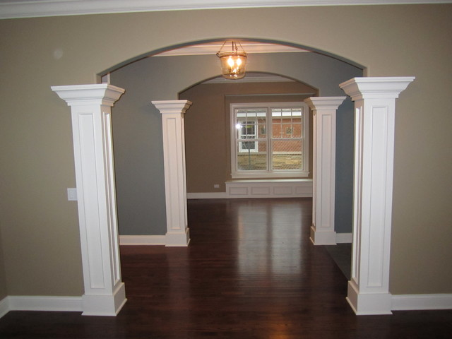 Arched Openings Connecting The Foyer To Dining Room