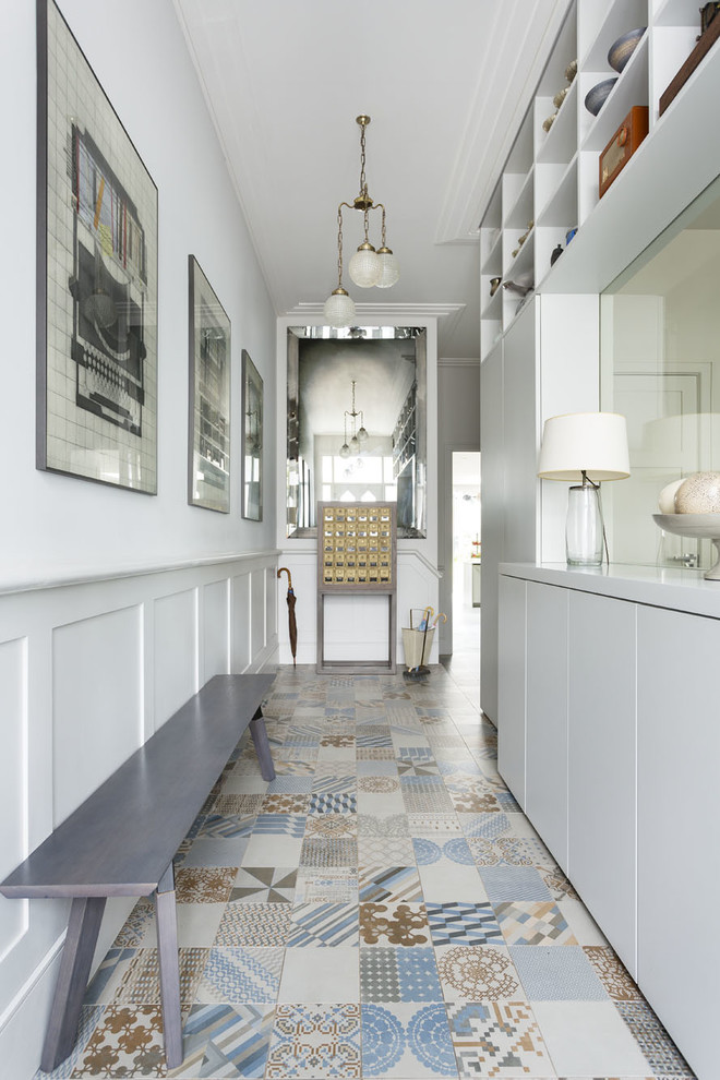 Transitional hallway photo in London with white walls