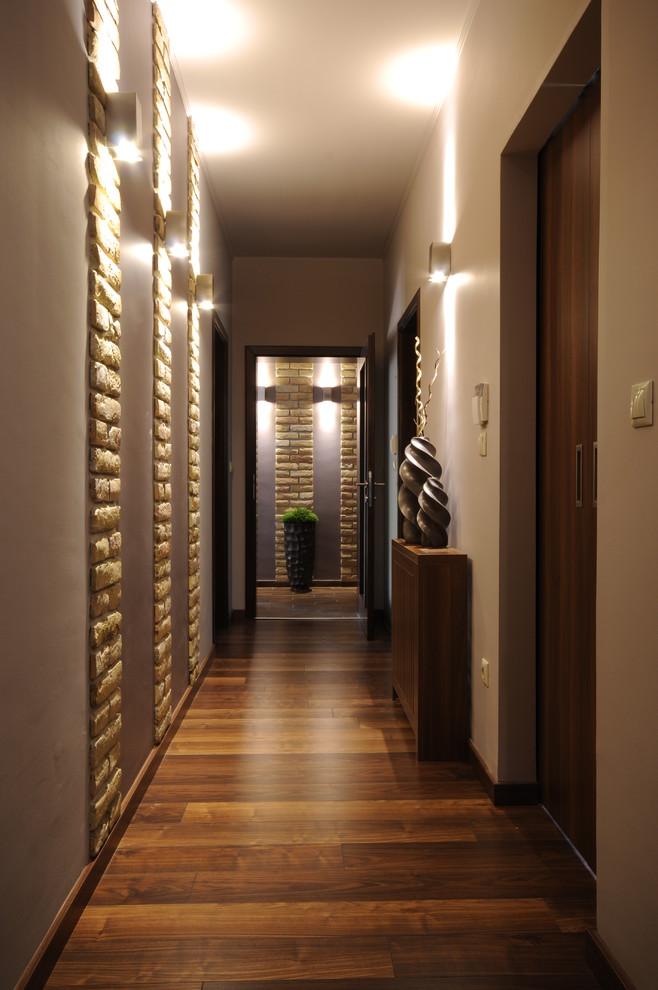 Trendy hallway photo with white walls