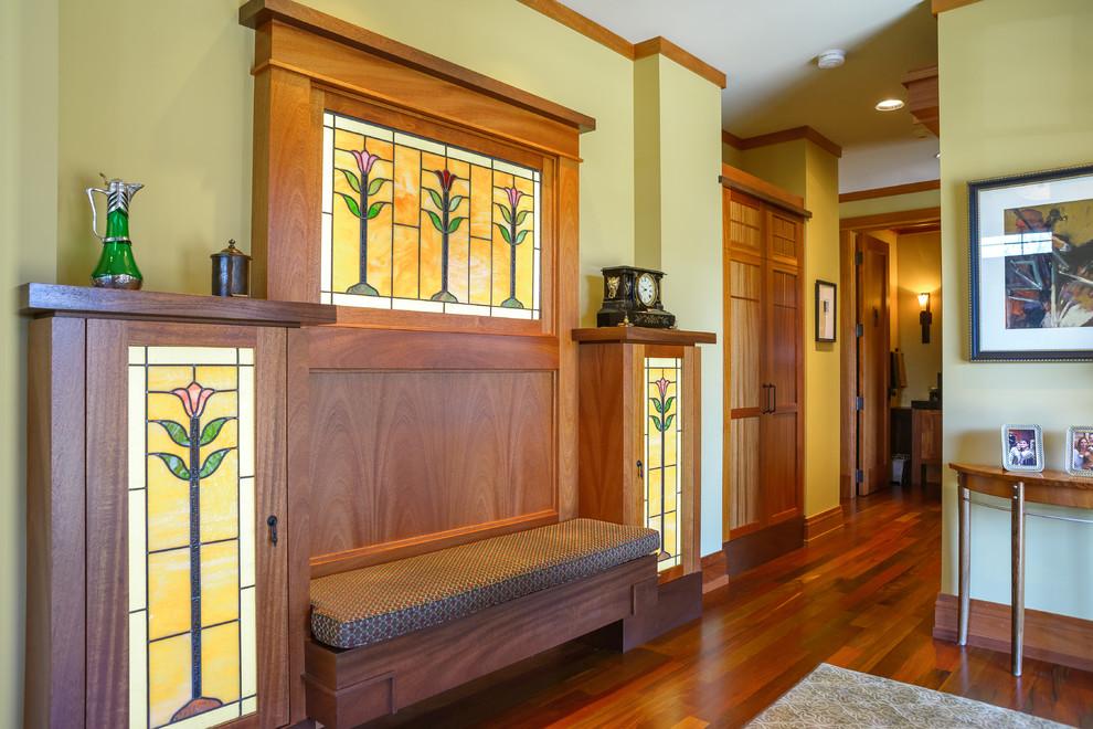 Arts and crafts dark wood floor hallway photo in Minneapolis with yellow walls
