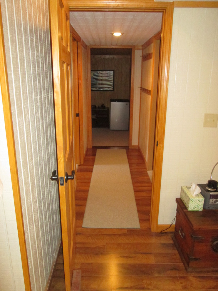 Example of a mid-sized country dark wood floor hallway design in Indianapolis with beige walls