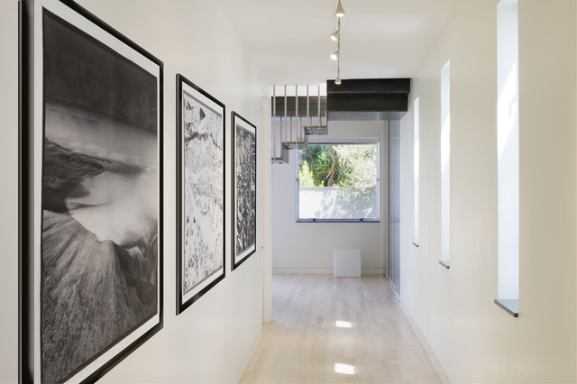 Inspiration For A Modern Light Wood Floor Hallway Remodel In San Francisco  With White Walls Photo