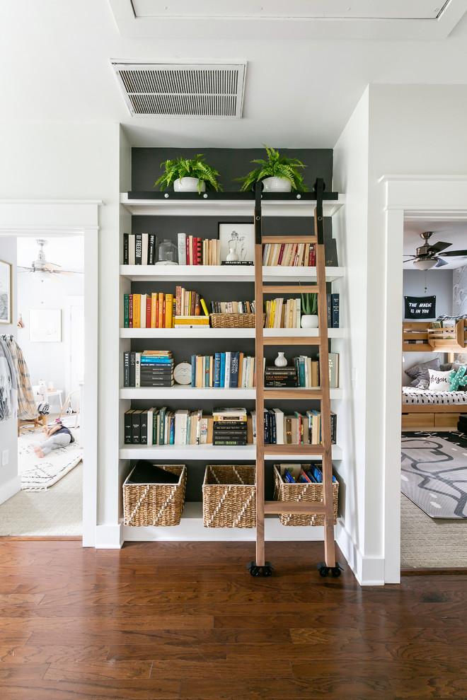 Hallway - medium tone wood floor and brown floor hallway idea in Charleston with white walls