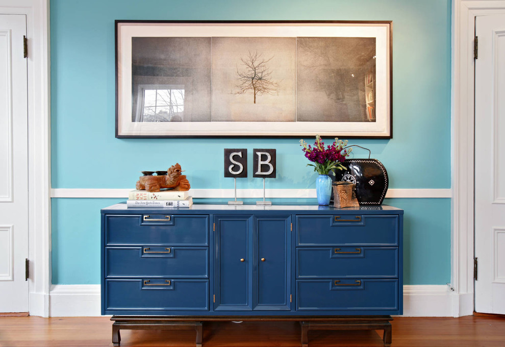 Inspiration for an eclectic hallway remodel in Boston with blue walls