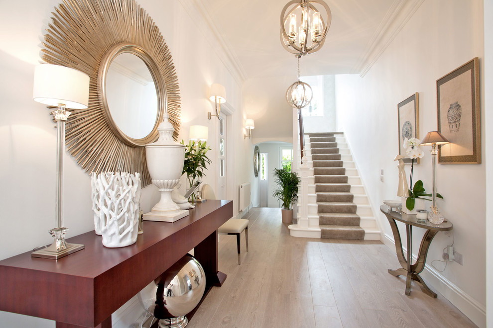 Inspiration for a transitional medium tone wood floor hallway remodel in Other with white walls
