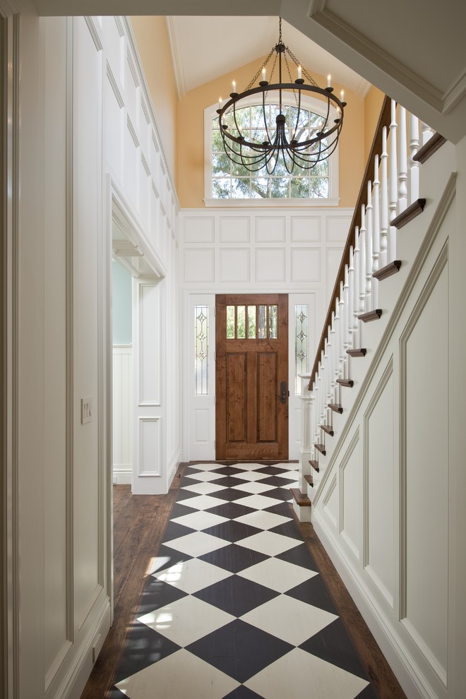 Example of a classic dark wood floor and multicolored floor hallway design in San Francisco with white walls