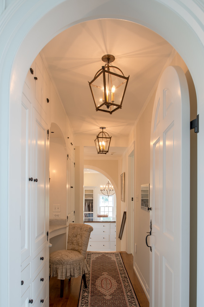 Inspiration for a huge timeless medium tone wood floor hallway remodel in Philadelphia with white walls
