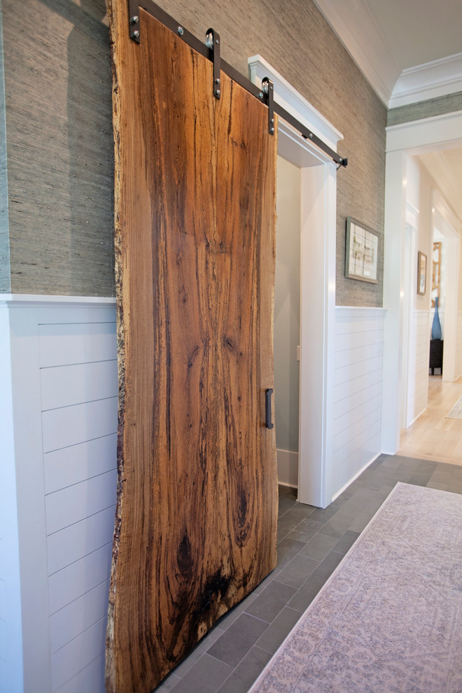 Example of a large farmhouse slate floor hallway design in Atlanta with multicolored walls
