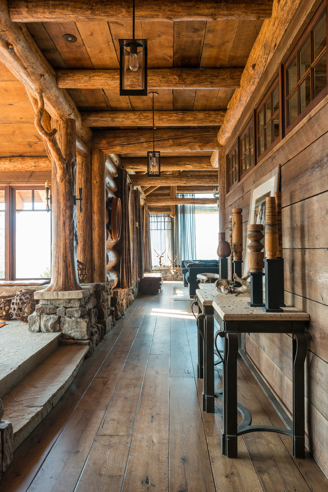 Inspiration for a rustic medium tone wood floor hallway remodel in Other