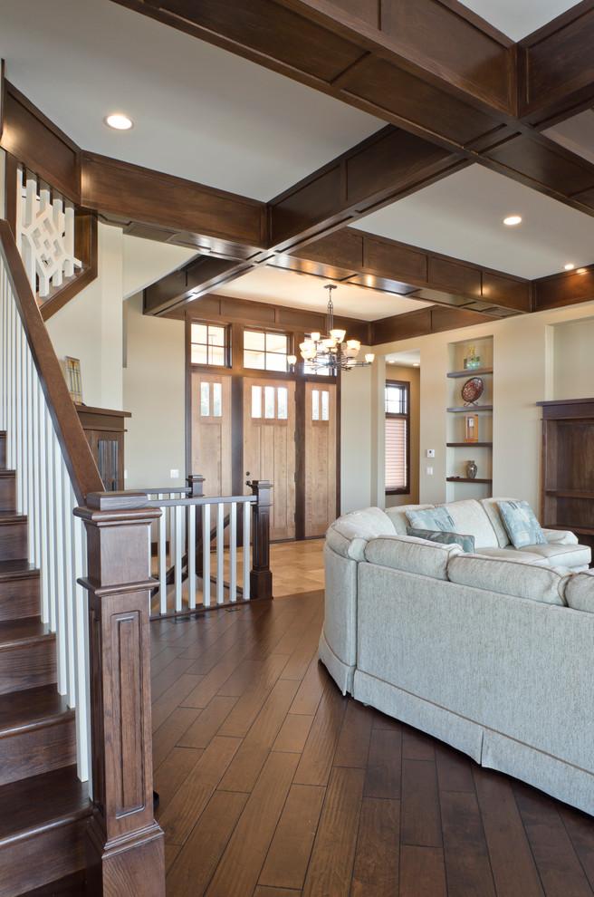 Mid-sized elegant dark wood floor hallway photo in Tampa with beige walls