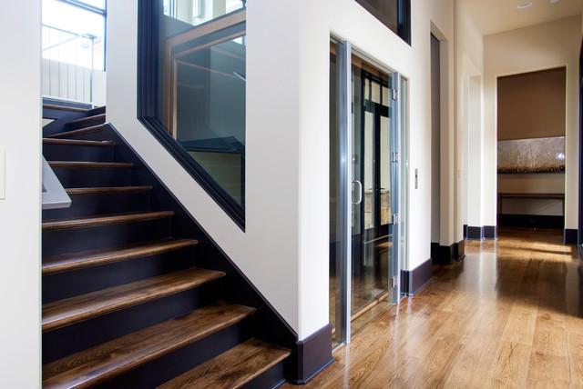 Custom glass elevator with power sliding glass doors for Custom home elevator
