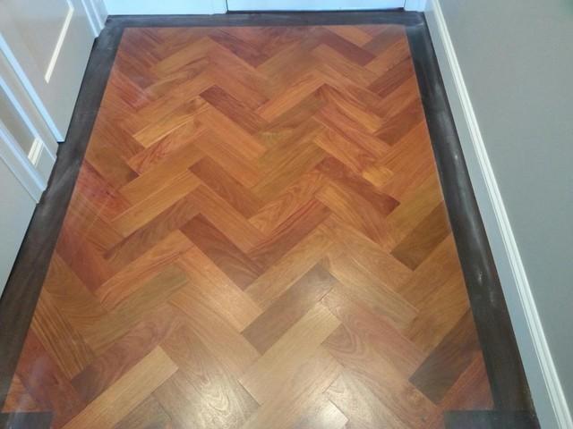 Custom mahogany floor with herringbone pattern and walnut for Hardwood floor dealers
