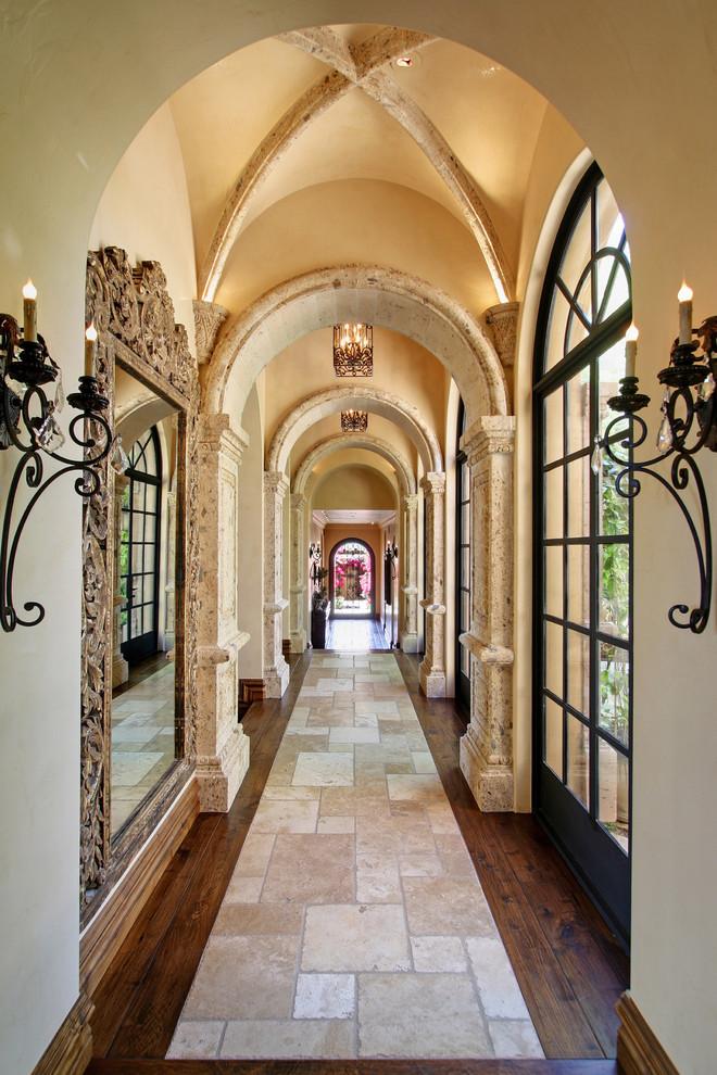 Hallway - mediterranean dark wood floor and multicolored floor hallway idea in Phoenix with beige walls