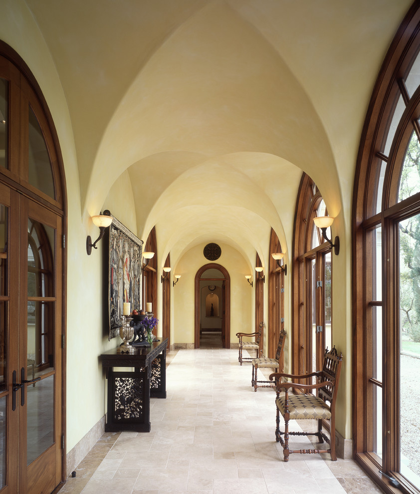 Inspiration for a large mediterranean hallway remodel in Austin with beige walls