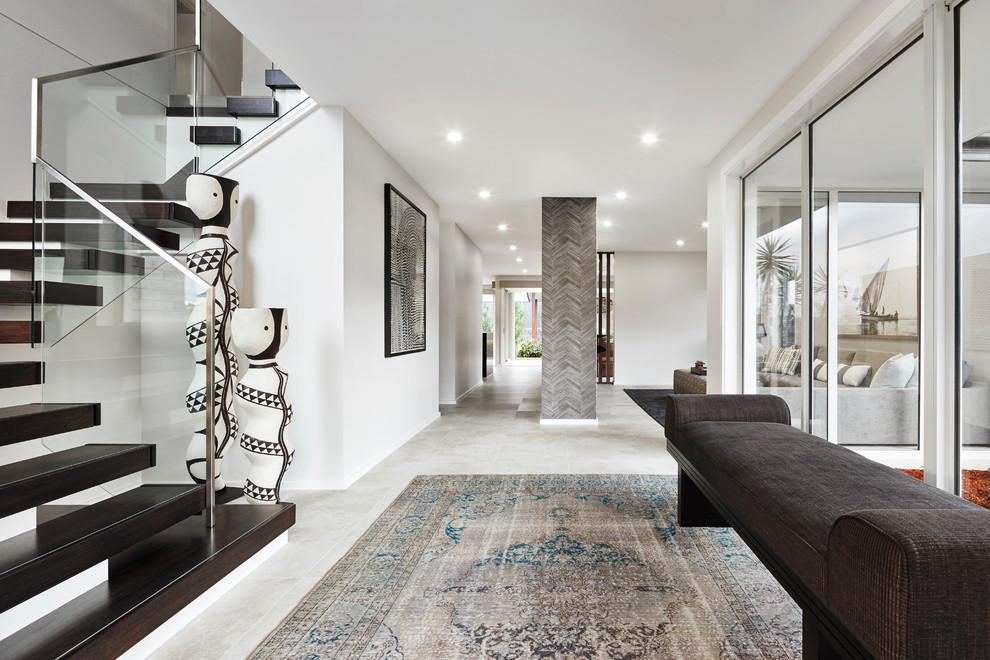 Hallway - contemporary gray floor hallway idea in Sydney with white walls