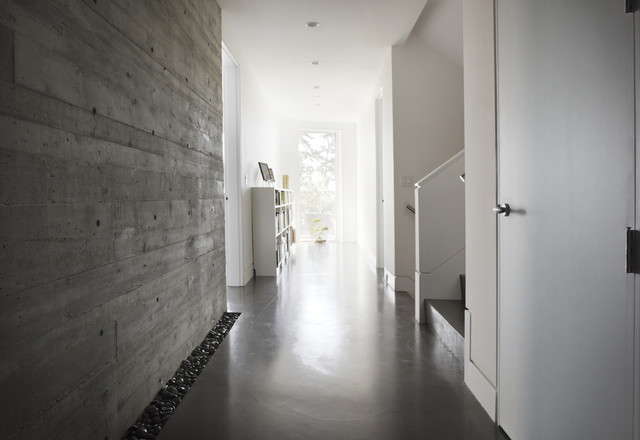 example of a minimalist hallway design in vancouver with concrete floors
